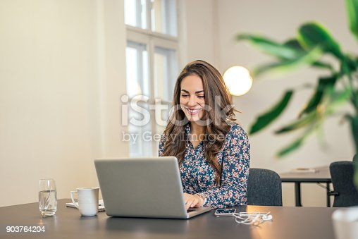 istock Shot of an executive businesswoman working on her laptop in office. 903764204