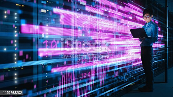 Shot of Asian IT Specialist Using Laptop in Data Center Full of Rack Servers. Concept of High Speed Internet with Pink Neon Visualization Projection of Binary Data Transfer