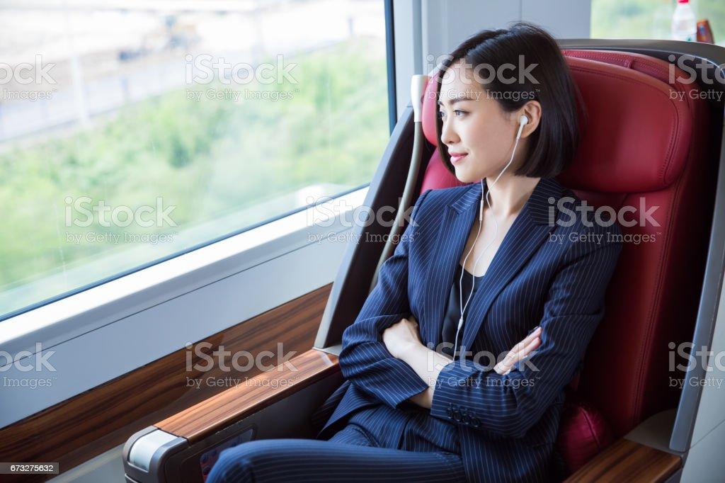 shot of beautiful business woman sitting inside high-speed train,Shanghai,China. royalty-free stock photo