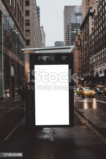 Shot of blank billboard to copy space on bus station in Manhattan, New York City. Horizontal shot.