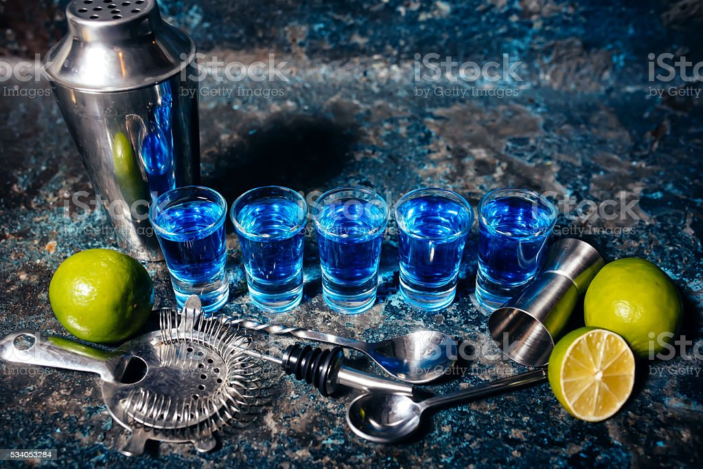 shot of blue curacao alcoholic drinks, shot blue cocktails stock photo