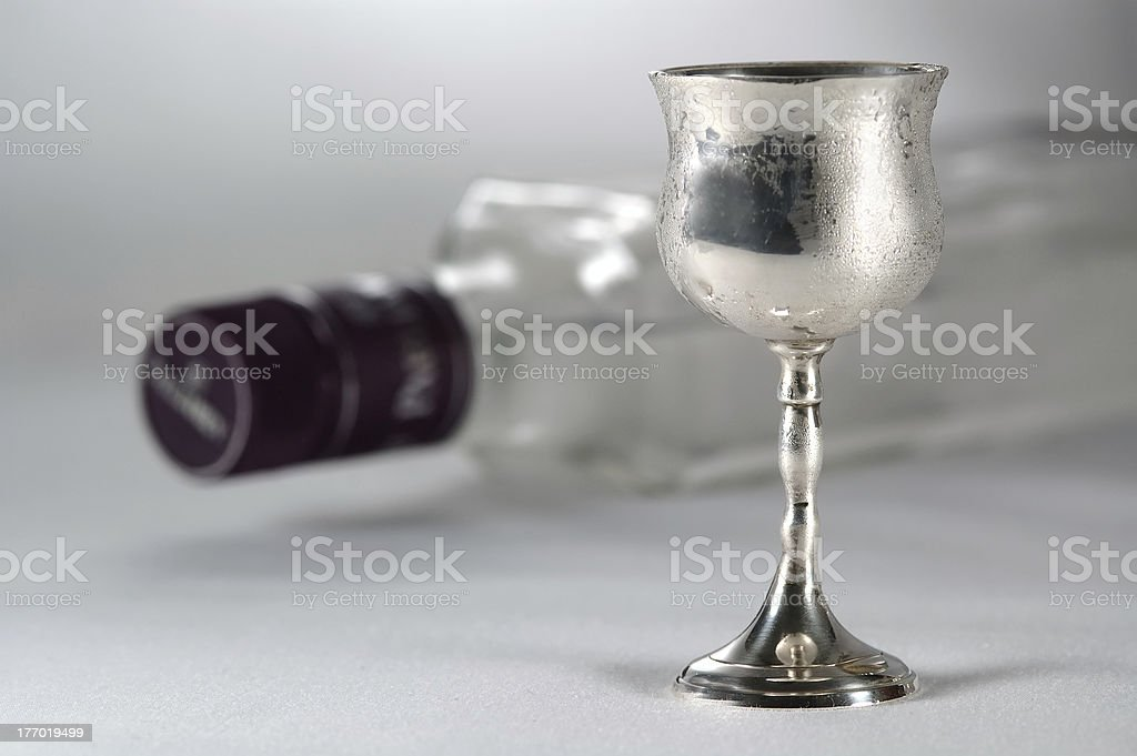 Shot of chilled hard liquor with bottle as a background stock photo