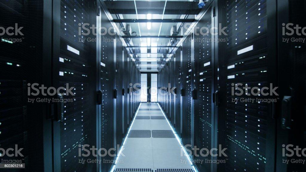 Shot of Corridor in Working Data Center Full of Rack Servers and Supercomputers. stock photo