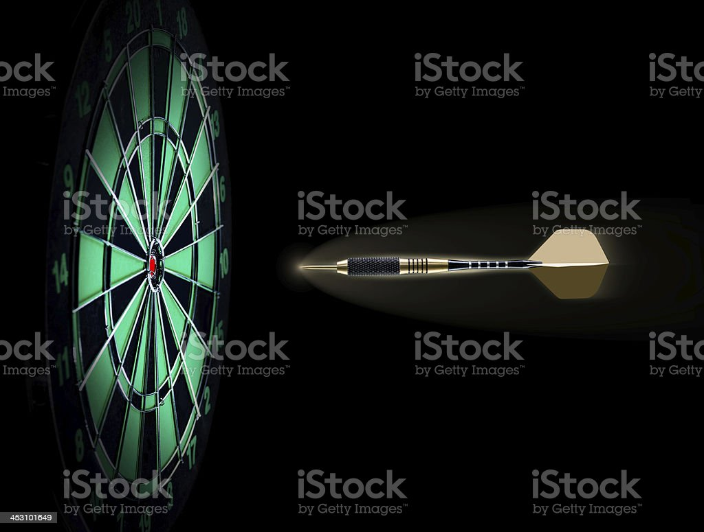 Shot of darts in bullseye on dartboard royalty-free stock photo