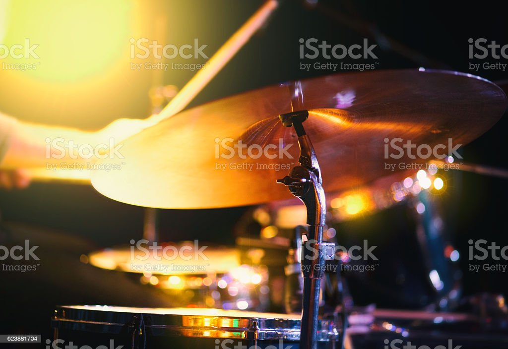 Shot of Drummer playing  cymbal in colorful mood on stage stock photo