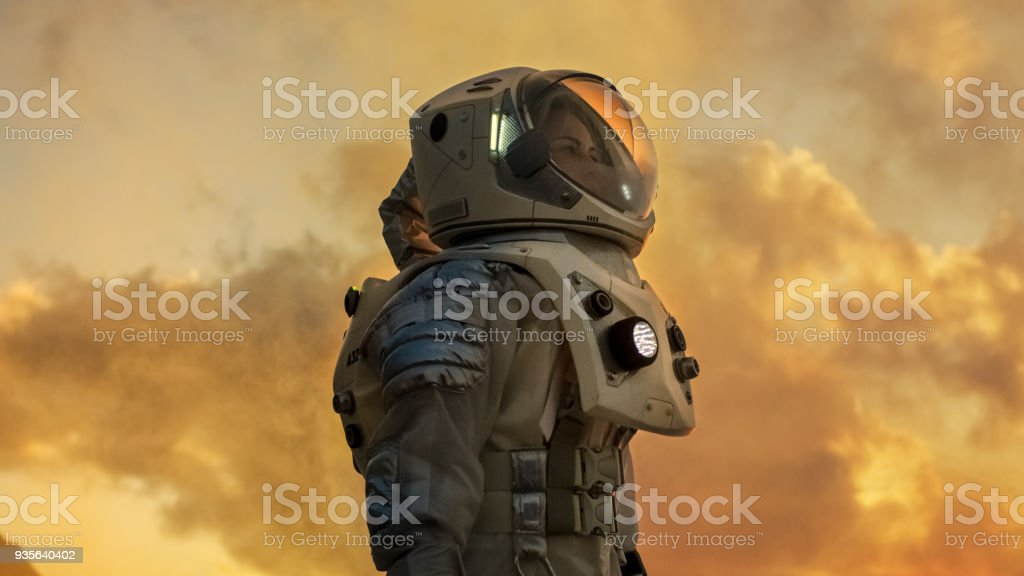 Shot Of Female Astronaut In The Space Suit Looking Around