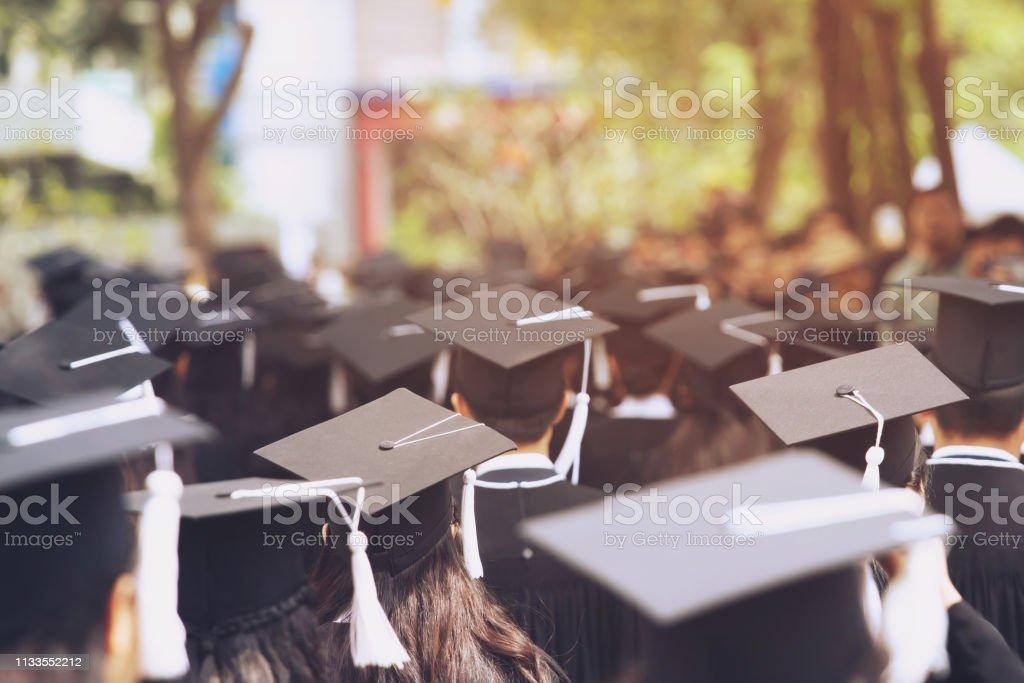 shot of graduation hats during commencement success graduates of the...