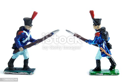 Photo of handmade tin soldiers on the white background