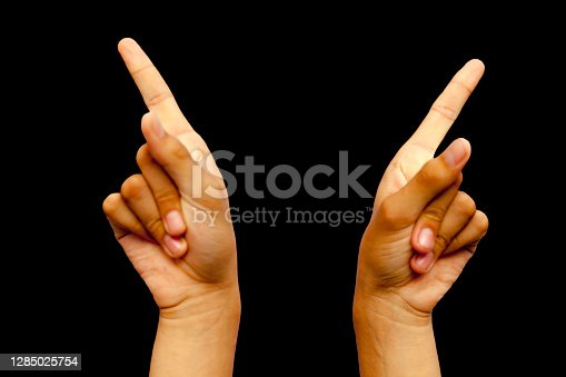 Shot of hands demonstrating Suchi Mudra isolated on black background.