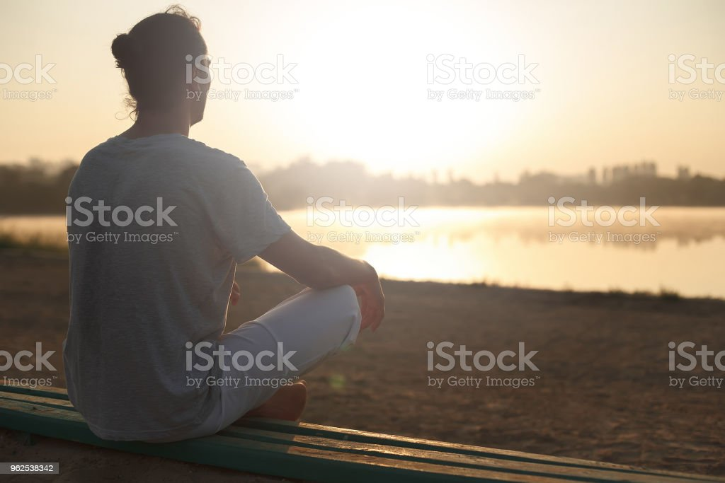 Shot of healthy young man taking a break after morning workout. - Royalty-free Adult Stock Photo