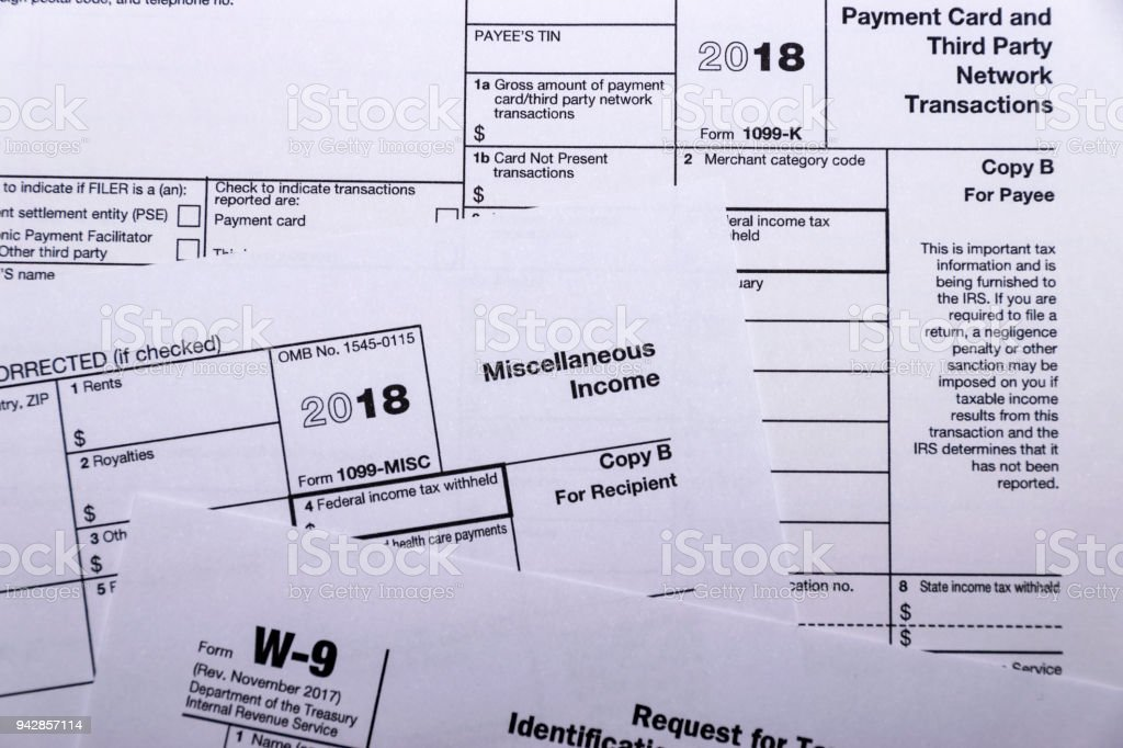 Shot of IRS tax forms 1099-M, 1099-K and W-9 stock photo