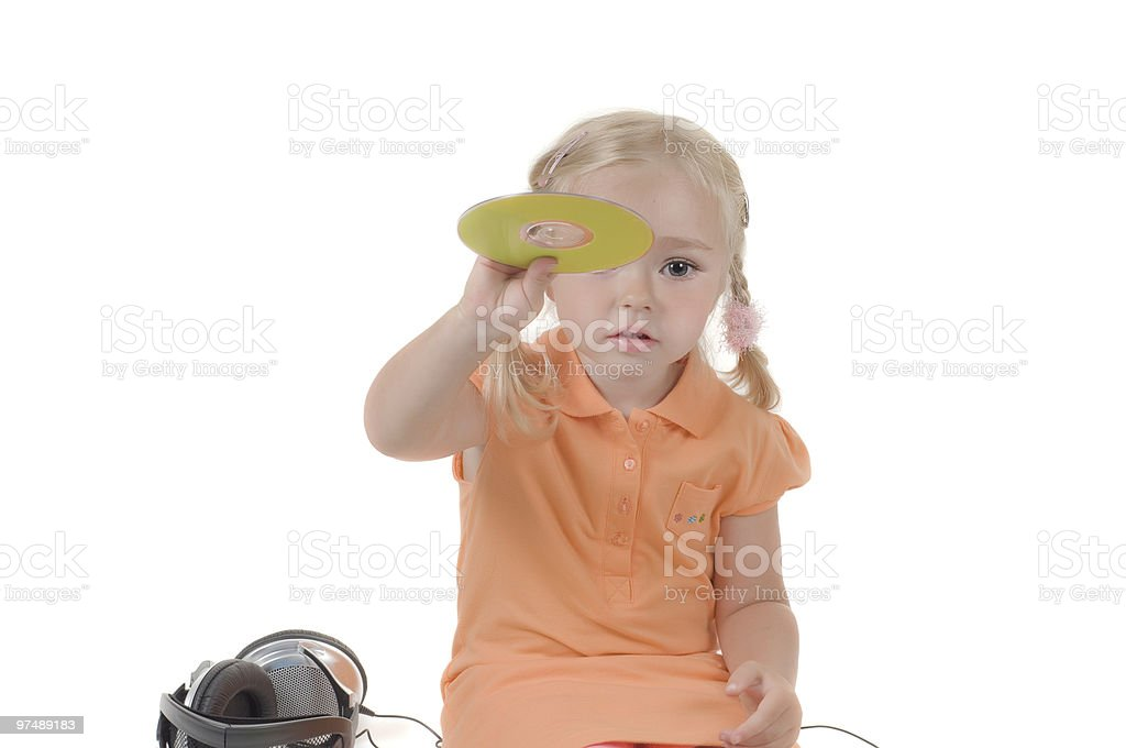 Shot of little girl with CD in studio royalty-free stock photo