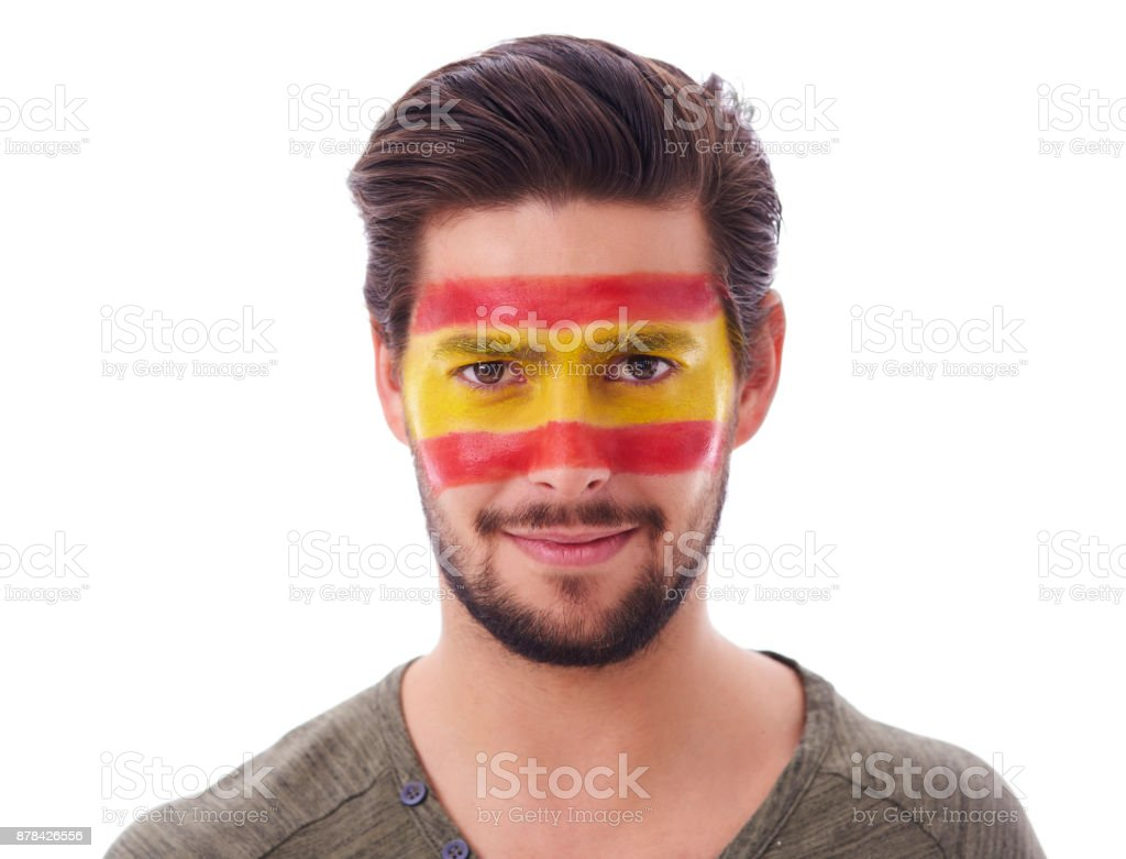 Shot of male spain soccer fan at studio shot - foto stock