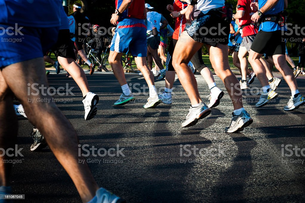Shot of marathon runners shoes on asphalt royalty-free stock photo