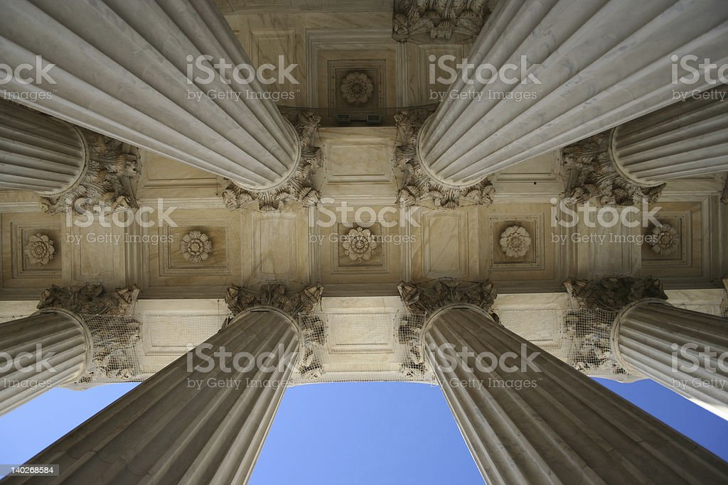 Shot of marble columns at the Supreme Court, from below royalty-free stock photo