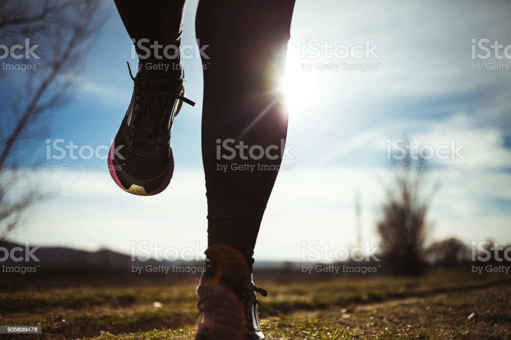 Shot of runner's shoes in nature stock photo
