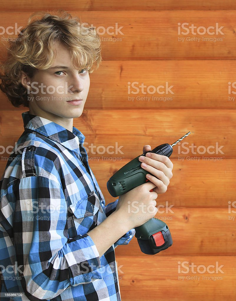 Shot of teenager boy with electric drill royalty-free stock photo