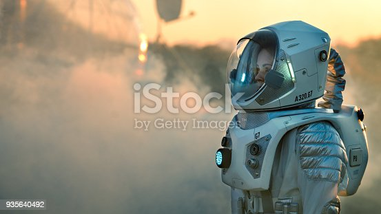 istock Shot of the Astronaut On Mars Walking Toward His Base/ Research Station, Looking Around. First Manned Mission To Mars, Technological Advance Brings Space Exploration, Colonization. 935640492