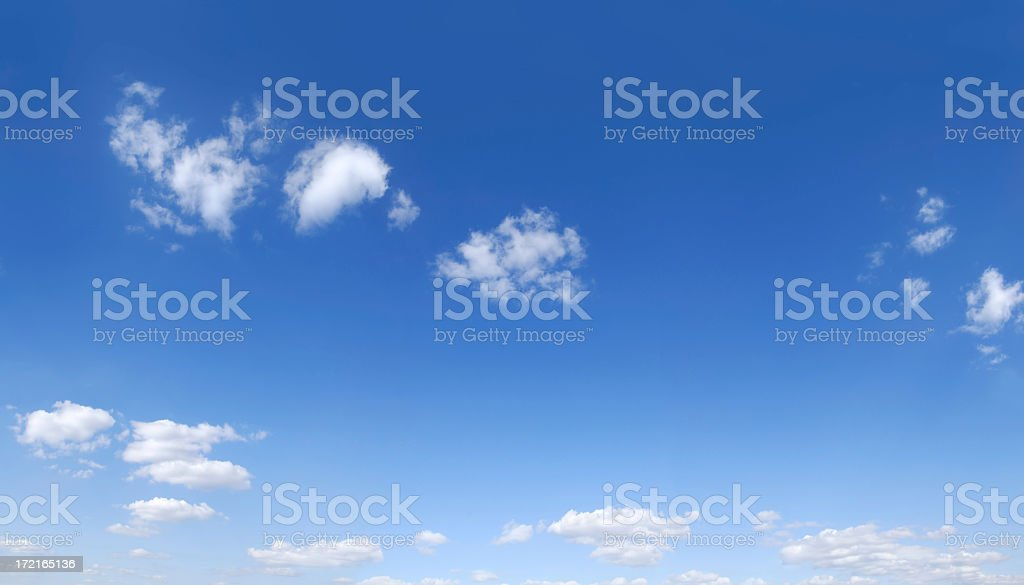 A shot of the blue sky and white clouds on a clear day royalty-free stock photo