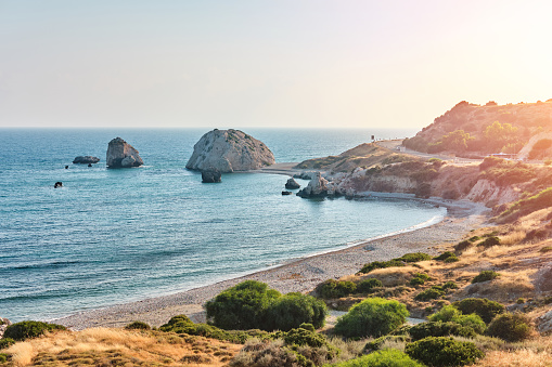 istock Shot of the coast of Aphrodite's birthplace near Paphos city, Cyprus. A popular holiday destination. Tourism, vacation, traveling, leisure concept 1179996298