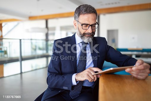 Shot of thinking financial advisor businessman working at office.