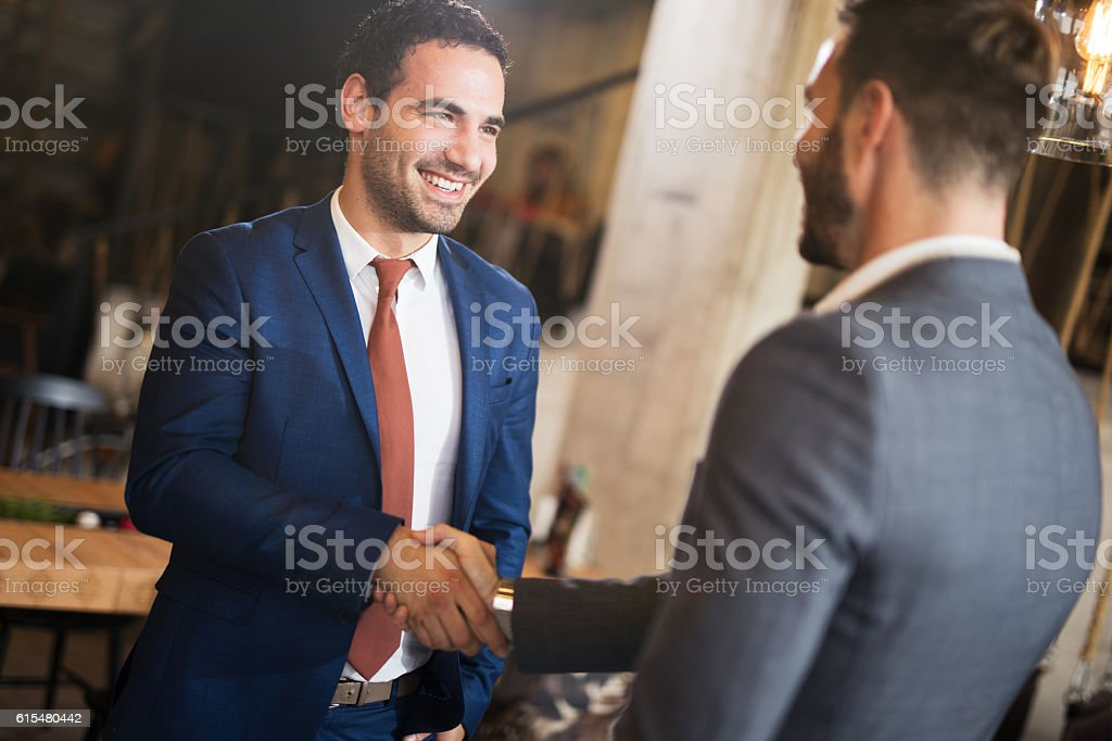 Shot of two businessmen shaking hands. stock photo