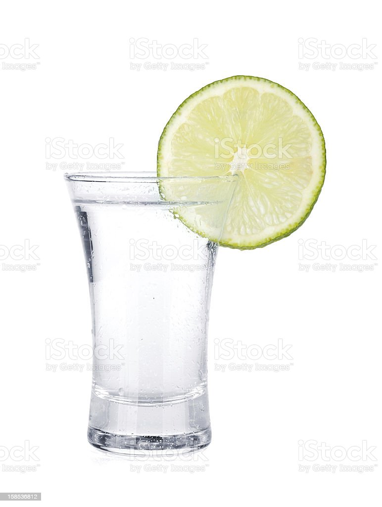 Shot of vodka and lime slice royalty-free stock photo