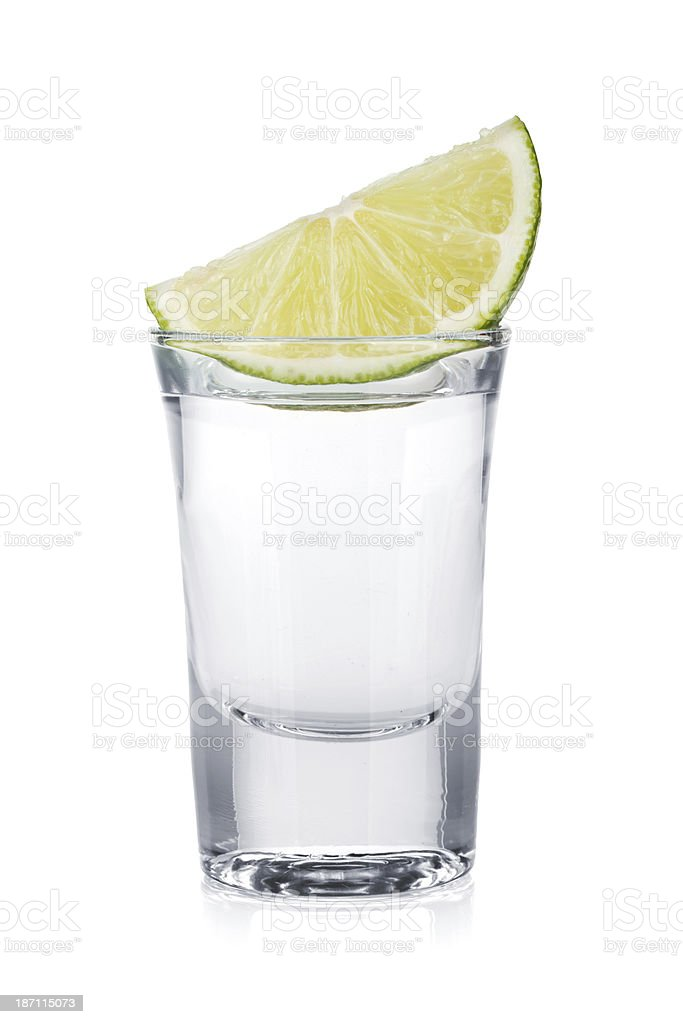 Shot of vodka and lime slice stock photo