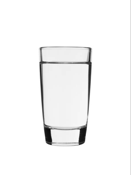 a shot of vodka on a white background - доза стоковые фото и изображения