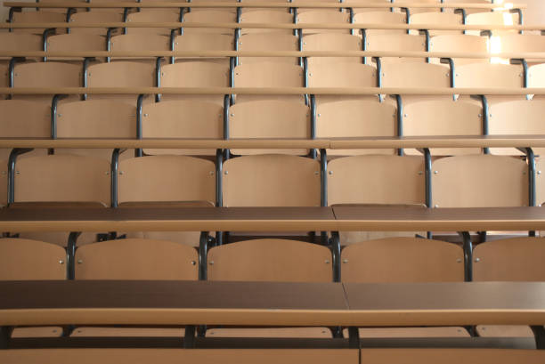 Shot of well organized empty university classroom seats due to global pandemic stock photo