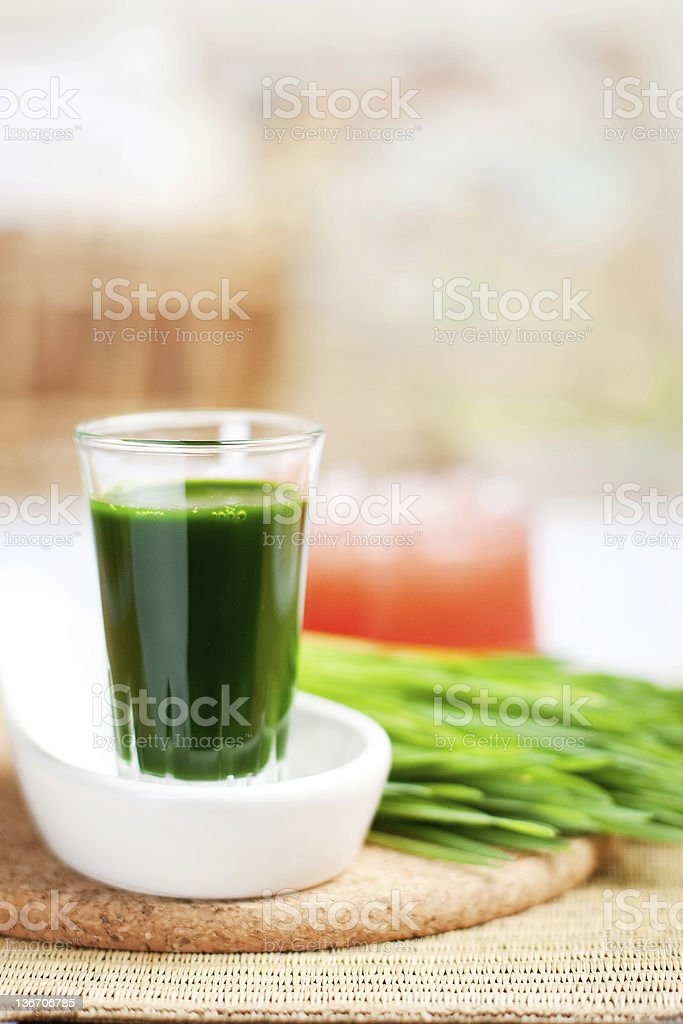 shot of wheatgrass juice stock photo