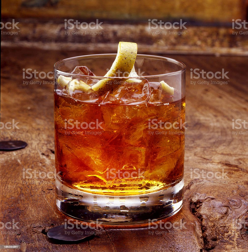 Shot of whiskey with a lemon peel stock photo