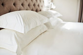 istock Shot pillows on a bed in a modern hotel 1324159774