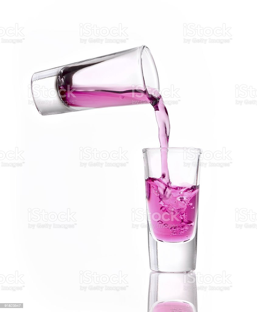 Shot pouring pink liquor royalty-free stock photo