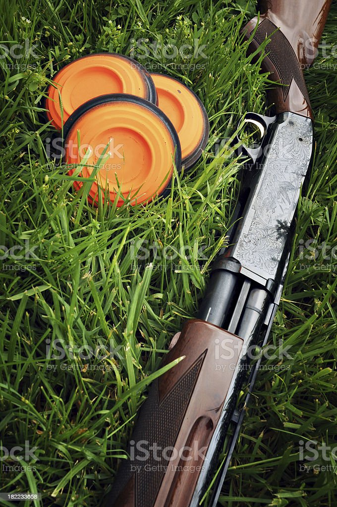 Shotgun and Clay Pigeons stock photo