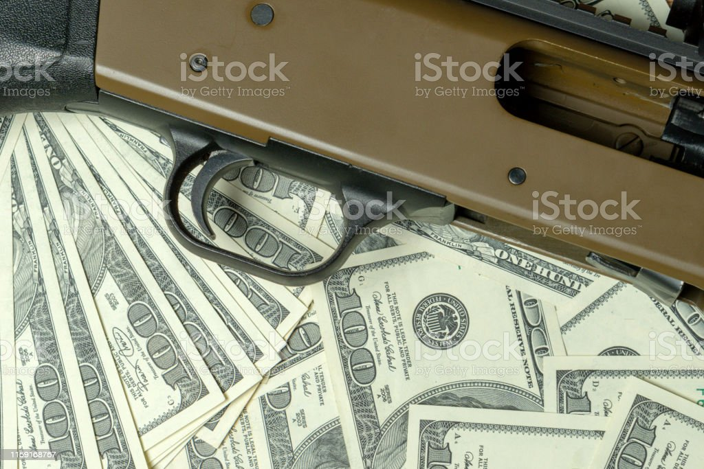 Shotgun on dollars. Concept for crime, global arms trade, weapons...