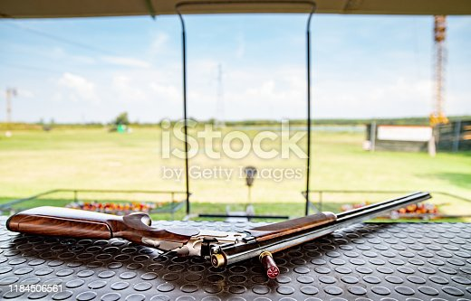 Shotgun on Table on Shooting Range Outdoors.