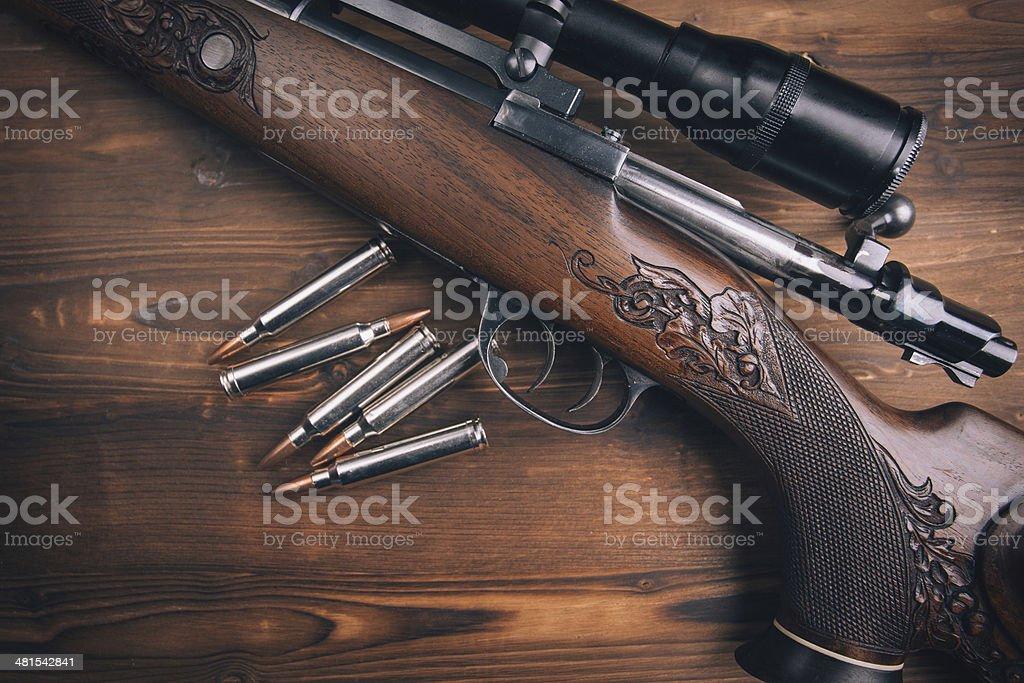 Shotgun on wooden background stock photo