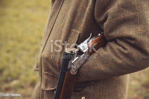 istock Shotgun open over hunter forearm 1092790444