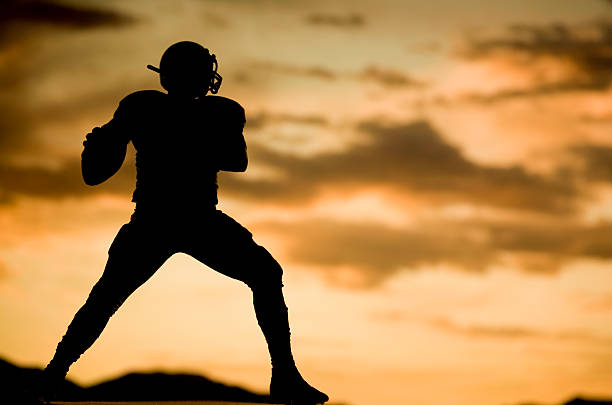 Shotgun silhouette shot of football players quarterback stock pictures, royalty-free photos & images