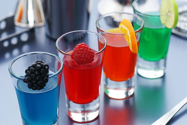 "Shots mixed with different fruits ""Four colorful jello shots with fresh fruit garnishes.Same shot vertically, and a bunch of other drinks you desperately need:"" gelatin stock pictures, royalty-free photos & images"