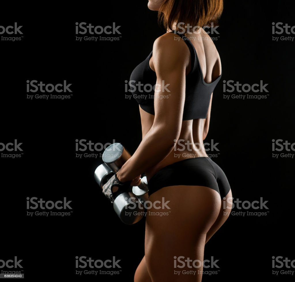 Shots of a fit female with dumbbells - foto de acervo
