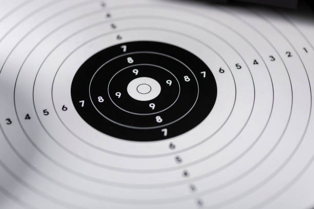 shots, shields and cartridges - shooting position on the sport shooting range - sports target stock photos and pictures