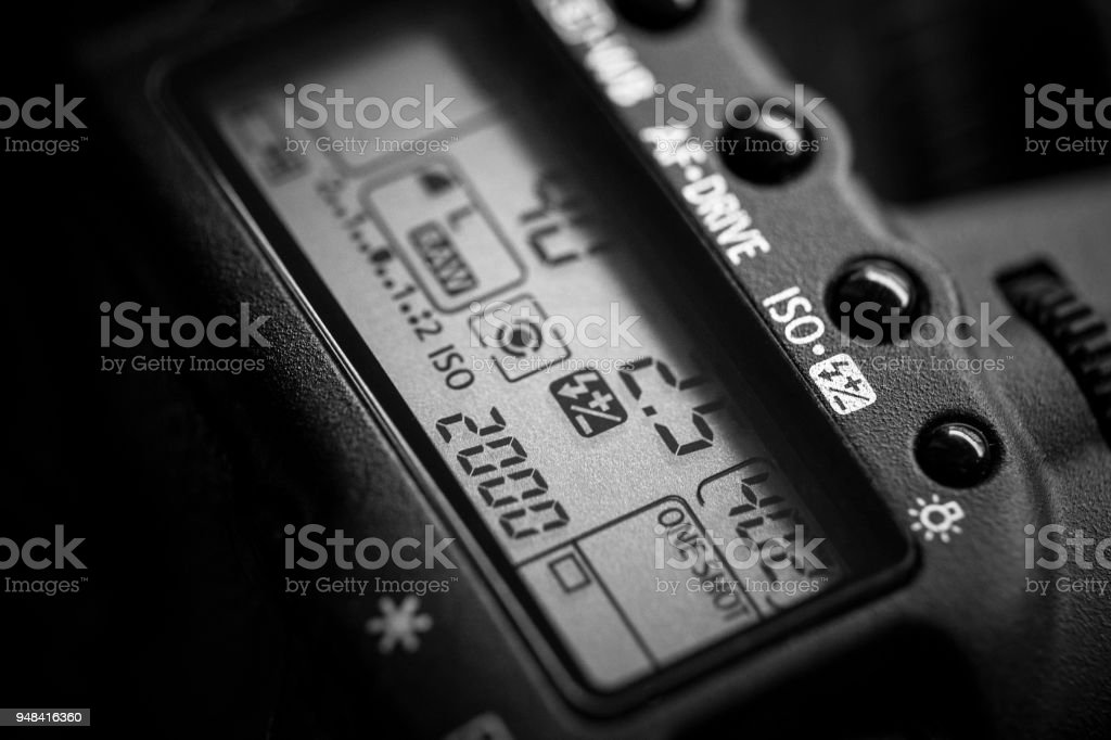Shoulder display of a reflex camera with focus on the ISO setting stock photo