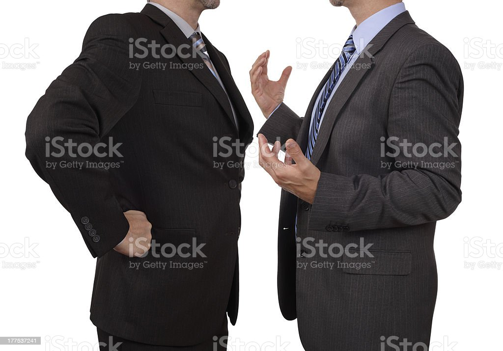 Shoulder down view of two businessmen having a confrontation royalty-free stock photo