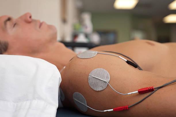 Shoulder Electrical Stimulation / TENS stock photo