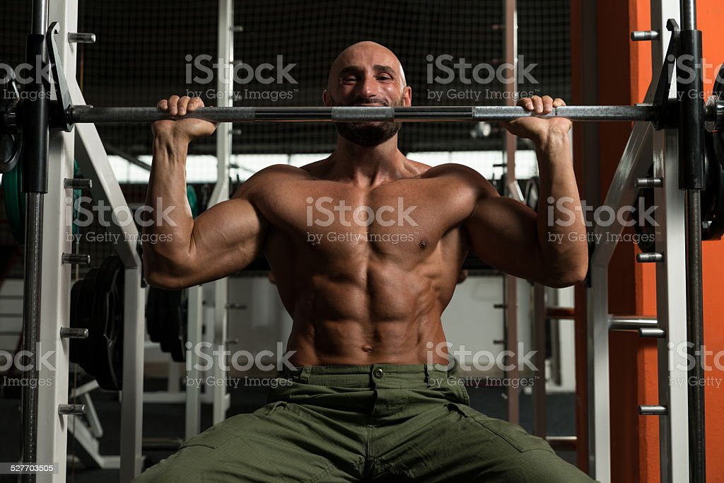 Shoulder Exercises On A Smith Machine stock photo