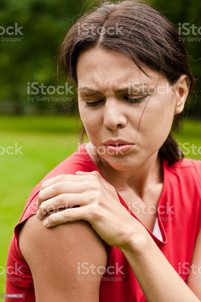 Shoulder injury - sportswoman in pain stock photo