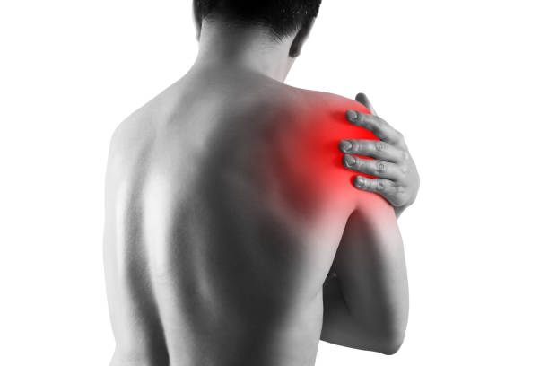 Shoulder pain, ache in a man's body, sports injury concept, isolated on white background stock photo