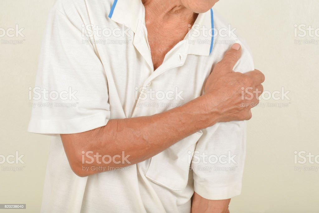 Shoulder pain in the elderly stock photo